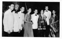 """Cocktails at """"300 Club"""" of Indonesian Consul General, May 29th, 1957. L to R: Unidentified, Dr. Santakh Singh, Rudy Gontha (retiring Indonesian Consul-General), Eloise, Mr. T.A. Mochtar (incoming Indonesian Consul-General), Fie Gontha, George, Mrs. Mochtar."""