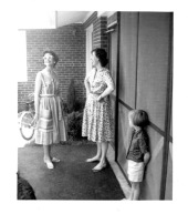 Clarkie Walton (mother of Ann & Cathy), Eloise, Cathy outside our screened carport
