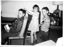 "Feb. 1965: ""Playing barbershop!"" Michael 11, Frank 6, Louisa 4"